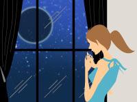 部屋の窓から女性が月見